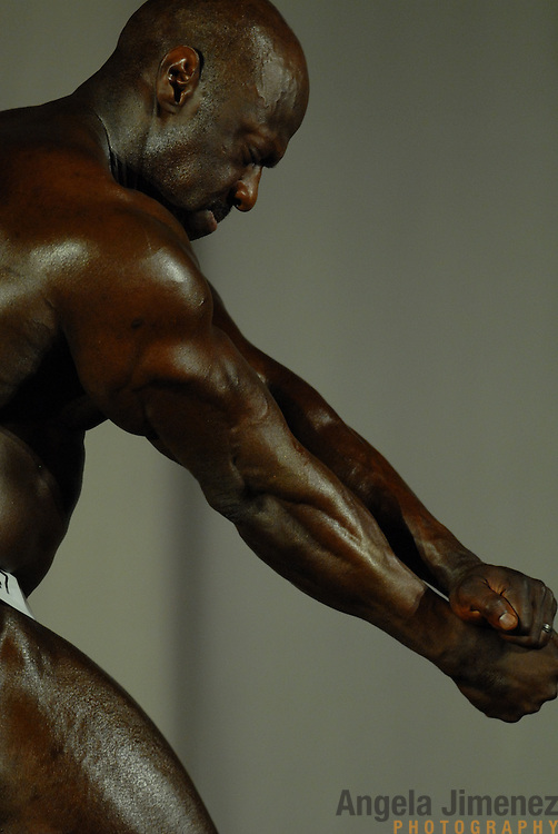 Gene Hendricks, of Chicago, Illinois, poses during the Physique (bodybuilding) competition 40-49 year old age group heavyweight division at McGaw Memorial Hall/Welsh-Ryan Arena at Northwestern University in Evanston, Illinois during the Gay Games VII competition on July 19, 2006. <br /> <br /> Hendricks finished third in the standard category of his division. <br /> <br /> Over 12,000 gay and lesbian athletes from 60 countries are in Chicago competing in 30 sports during the Games from July 15 through 22, 2006. <br /> <br /> Over 50,000 athletes have competed in the quadrennial Games since they were founded by Dr. Tom Wadell, a 1968 Olympic decathlete, and a group of friends in San Francisco in 1982, with the goal of using athletics to promote community building and social change. <br /> <br /> The Gay Games resemble the Olympics in structure, but the spirit is one of inclusion, rather than exclusivity. There are no qualifying events or minimum or maximum requirements.<br /> <br /> The Games have been held in Vancouver (1990), New York (1994), Amsterdam (1998), and Sydney (2002).