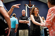 Republican presidential candidate Rep. Michele Bachmann greets churchgoers at Living Word Outreach Ministries in Spencer, Iowa, July 31, 2011 while campaigning througout the state in advance of the Straw Poll.