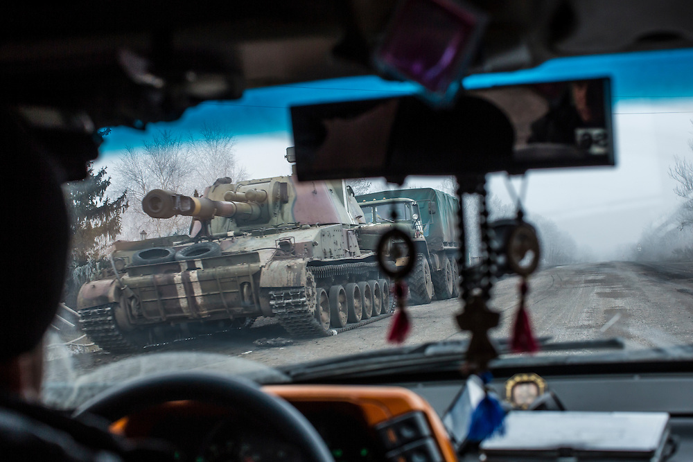 ARTEMIVSK, UKRAINE - FEBRUARY 14: A Ukrainian self-propelled gun drives on the road away from the embattled town of Debaltseve on February 14, 2015 in Artemivsk, Ukraine. A ceasefire between Ukrainian forces and pro-Russian rebels is scheduled to go into effect at midnight. (Photo by Brendan Hoffman/Getty Images) *** Local Caption ***