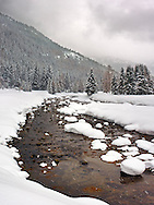 This is the Orco river near the small village of Ceresole Reale in the Gran Paradiso National Park, Piedmont,  Italy. I took this picture in a late afternoon at the beginning of February 2009, while it was snowing. I think it is a fair portrait of the exceptional snowfalls of winter 2009. At the time this picture was taken already three meters of snow had fallen at an altitude of about 1500 m..This is a mosaic of 3 horizontal frames, for a full size image of about25 Mp.
