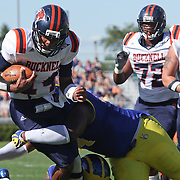 Bucknell Quarterback Brandon Wesley (14) is tackled by Delaware Defensive tackle Zach Kerr (94) during a Week 3 NCAA football game against Delaware...#13 Delaware defeated The Bison of Bucknell 19 - 3 at Delaware Stadium Saturday Sept. 15, 2012 in Newark Delaware.
