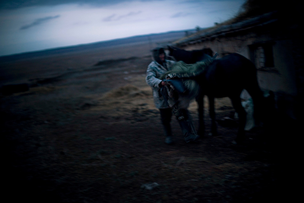 CREDIT: DOMINIC BRACCO II..SLUG:PRJ/KAZAKHSTAN SHEEP HERDERS..DATE:10/22/2009..CAPTION:Alen Popov takes off his horses saddle as it nears dark outside Semey, Kazakhstan. The herders live near an atomic lake which was made during the 1970s as part of an experiment by the USSR to create lakes from atomic bombs. The lake is in an area known as The Polygon, a test site for more than 400 of the Soviet Union's nuclear weapons.