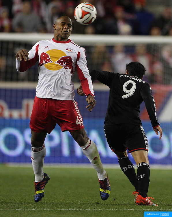 Jamison Olave, (left), New York Red Bulls, heads clear while challenged by Fabian Espindola, DC United, during the New York Red Bulls V DC United, MLS Cup Playoffs, Eastern Conference Semifinals first leg at Red Bull Arena, Harrison, New Jersey. USA. 2nd November 2014. Photo Tim Clayton