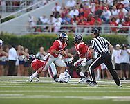Ole Miss quarterback Barry Brunetti (11) runs at Vaught-Hemingway Stadium in Oxford, Miss. on Saturday, September 1, 2012. (AP Photo/Oxford Eagle, Bruce Newman)..