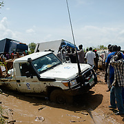 A Plan International 4WD vehicle stuck along a road just outside of Juba, the capital of South Sudan on 7 August 2014. Two trucks had become stuck, one of which remained there for at least five days despite effots to free it. During the rainy season, road travel in South Sudan becomes extremely challenging; some parts of the country become completely inaccessible.