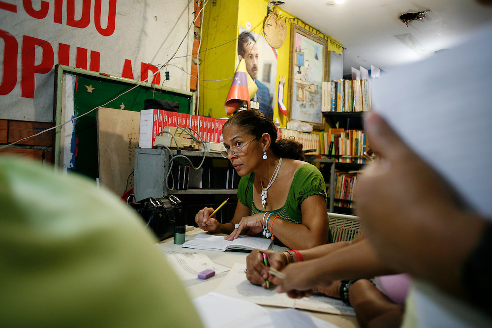 A student in the Ribas Mission takes notes while learning about the history of Venezuela. Missions are one of the most important parts of the Chavez government's social reforms. Teachers volunteer their time to teach young people and adults alike at all school levels through high school.