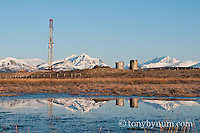 drill rigs set up to frack oil on the blackfeet reservation with rising wolf mountain glacier national park, montana, usa  the background