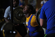 Kevin Whitney squats during Class 5A Region weightlifting competition at Oxford High School in Oxford, Miss. on Saturday, February 9, 2013.