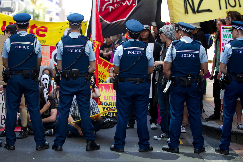 Demonstrators from the Occupy Auckland Camp protest outside SkyCity during the launch of the National Party General Election Campaign, Auckland, New Zealand, Sunday, October 30, 2011.  Credit:SNPA / David Rowland