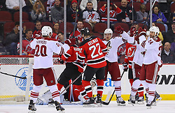 Mar 27, 2014; Newark, NJ, USA; The Phoenix Coyotes celebrate a goal by Phoenix Coyotes center Kyle Chipchura (24) on New Jersey Devils goalie Martin Brodeur (30) during the first period at Prudential Center.