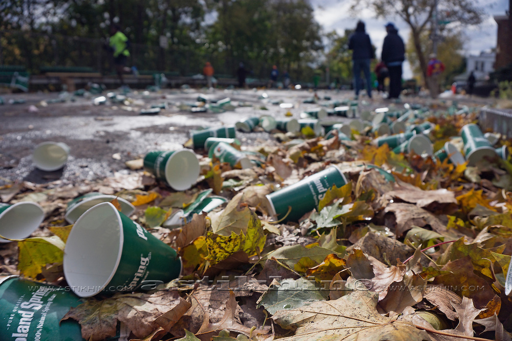 Plastic cups and leaves scattered over road during New York City Marathon.