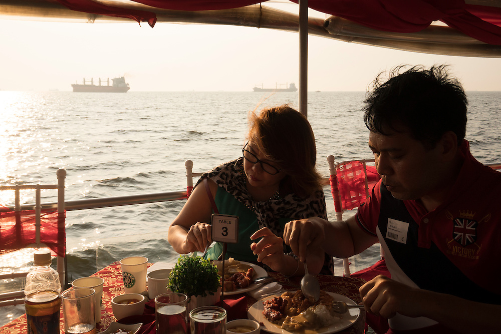 Maria Ethel Codina and husband Gleendo Pasmarinas enjoy a sunset dinner cruise around Manila Bay aboard Sun Cruises in Manila, Philippines. The hour-and-a-half boat ride serves a buffet style dinner and drinks as it travels along the coast line in the city.