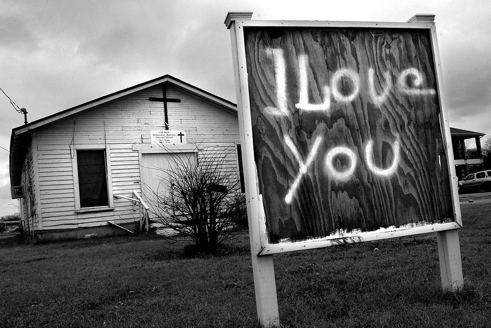 A closed church in Waco, Texas, bears a graffiti message of love.