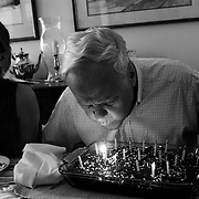 "Bob blows out candles as he and his family celebrate his 82th birthday.                            ..ltqmb   ""birthday blow"""