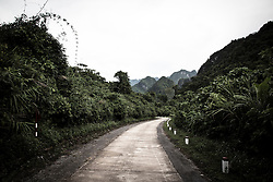 Mysterious road goes through the jungle in Phong Nha-Ke Bang National Park, Quang Binh Province, Vietnam, Southeast Asia