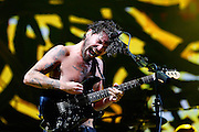 Simon Neil of Biffy Clyro performs live on the main stage during day three of Reading Festival at Richfield Avenue on August 25, 2013 in Reading, England.  (Photo by Simone Joyner)