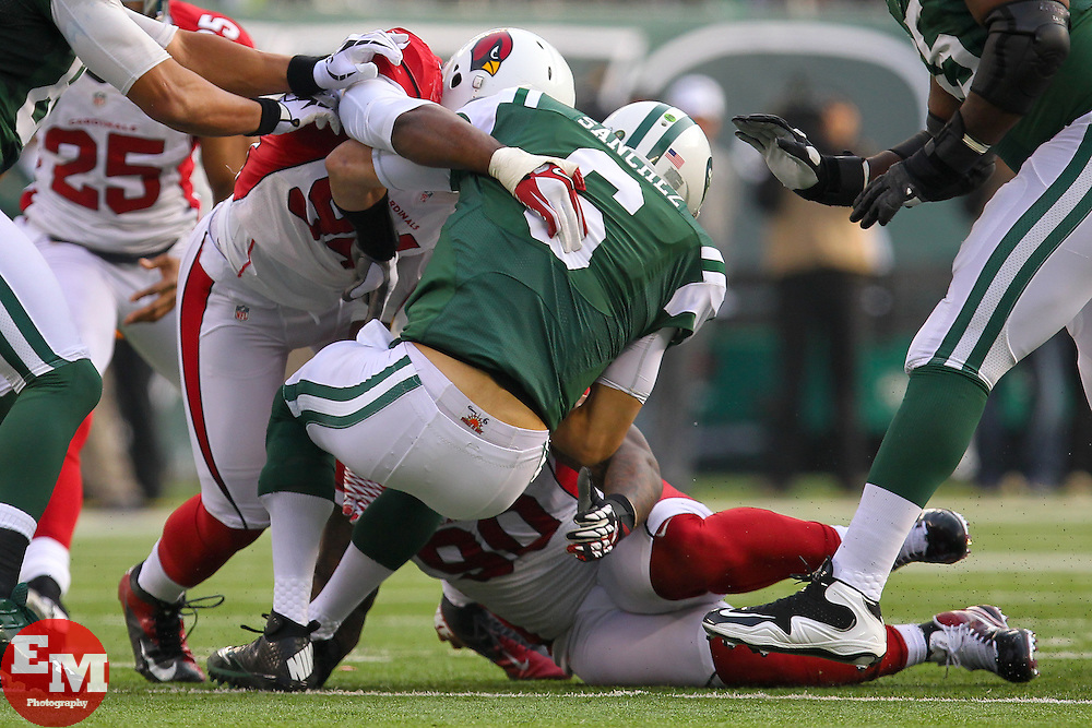 Dec 2, 2012; East Rutherford, NJ, USA; Arizona Cardinals outside linebacker Sam Acho (94) sacks New York Jets quarterback Mark Sanchez (6) during the first half at MetLIfe Stadium.