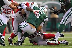 Dec 2, 2012; East Rutherford, NJ, USA; Arizona Cardinals outside linebacker Sam Acho (94) sacks New York Jets quarterback Mark Sanchez (6) during the first half at MetLIfe Stadium.