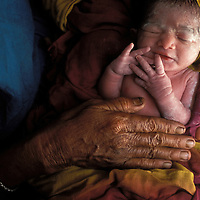 A newborn child in Bangladesh.  On average, the population of Earth increases by over 200,000 births every day.