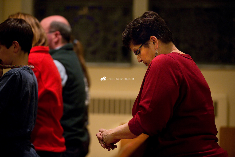 "Lisa Johnston  |  lisajohnston@archstl.org  |  @aeternusphoto  At the start to a night of violence after the announcment of no indictment by the St. Louis County prosecutor's office, people were already praying the rosary at Blessed Teresa of Calcutta Parish in Ferguson.  Archbishop Robert J. Carlson led the prayer service with Father Robert ""Rosy"" Rosebrough, pastor of Blessed Teresa."