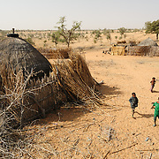 The home of Aisha Issa in the village of Kouka Samou in the Zinder region of Niger. Three of Aisha's five children survive; the youngest died weeks ago despite livesaving efforts at the Save the Children stabillisation centre in Kantche.