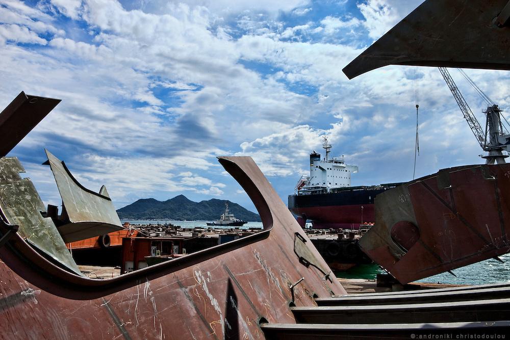Ship ATTALIA as seen through ship parts at the Tsuneishi shipyard.