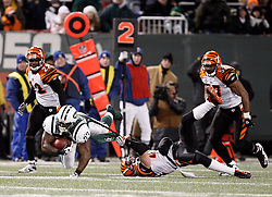 Jan 3, 2010; East Rutherford, NJ, USA; Cincinnati Bengals safety Tom Nelson (43) tackles New York Jets running back Shonn Greene (23) during the first half at Giants Stadium.