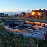 Canada, Manitoba, Churchill, Wooden skiff along Churchill River at sunset