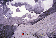 Toby Wilson leading the crux pitch of The Lotus Flower Tower, Cirque of the Unclimbables, NWT, Canada