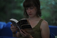 A woman reads The Reivers, written by Nobel Prize winning author William Faulkner, at the late writer's home of Rowan Oak in Oxford, Miss. on Friday, July 6, 2012. Faulkner died 50 years ago on July 6, 1962. Over 100 people are reading from the book to commemorate the occasion.