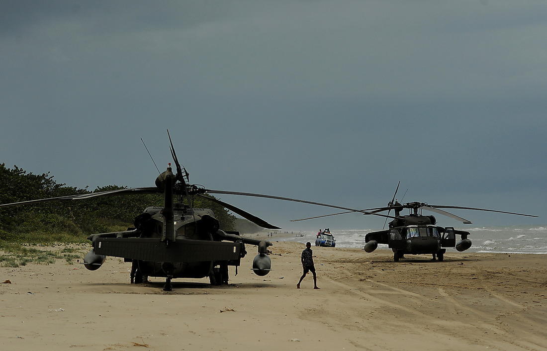 A young Honduran boy checks out a couple of UH-60 Black Hawks that are parked on the beach at the remote coastal village of Batalla. — © /