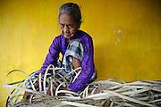 A weaver in the village of Mangindara, Makassar, Sulawesi, Indonesia.