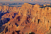 Palisades rock formations glow at Desertview Lookout near the East entrance of Grand Canyon NP.
