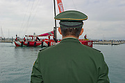 A Chinese officail waits for CAMPER with Emirates Team New Zealand dock after the finish of leg three in Sanya, Hainan province of southern China. Volvo Ocean Race 2011- 12. 4//2/2012