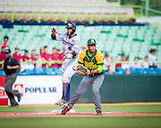 SAN JUAN, PUERTO RICO FEBRUARY 3: Carlos Paulino, a catcher for the Dominican Republic celebrates at third   during the game against Cuba on February 3, 2015 in San Juan, Puerto Rico at Hiram Bithorn Stadium(Photo by Jean Fruth)