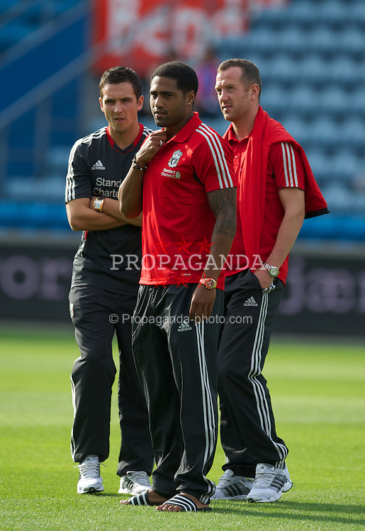 OSLO, NORWAY - Monday, August 1, 2011: Liverpool's Stewart Downing, Glen Johnson and Charlie Adam before the preseason friendly match against Valerenga at the Ulleval Stadion. (Photo by David Rawcliffe/Propaganda)