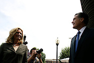 Former Massachusetts Governor and presidential hopeful Mitt Romney and his wife Ann(R) make their way through the town of Pella, Iowa during a campaign stop, June 30, 2007.