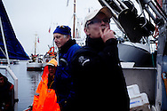 Vestfjorden, Nordland, Norway, 23.03.12..Arriving in the harbour to weigh in catch of the day after a long day at sea...The vessel Anne Marie with skipper Steinar Henriksen and (blue cap) brought out Team Olsen at the Arctic Cod fishing world championship. On the first day three man Team Olsen caught 1205 kilos of cod using nothing but fishing poles in the five hours of fishing time. The team; Geir L. Olsen (glasses), Magne Øvregård (white hat/red rainclothes) and Peder E. Vik (dark hair) won first prize this Friday in Lofoten Cup (Peder 1st, Magne 2nd and Geir 3rd)...Photo by: Eivind H. Natvig/MOMENT