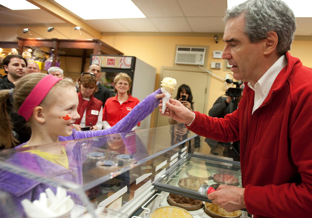 Liberal leader Michael Ignatieff makes an ice cream cone for a young girl during a campaign stop in Paris, Ontario April 30, 2011.<br /> REUTERS/Geoff Robins (CANADA)