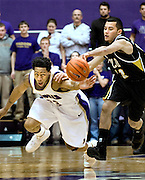01/02/08-(Harrisonburg).JMU's Juwann James dives for a loose ball against VCU's Joey Rodriguez during second half action at the JMU Convo in Harrisonburg on Wednesday. James hit the winning shot at the buzzer to lift JMU for the win 62-61..(Pete Marovich/Daily News-Record)