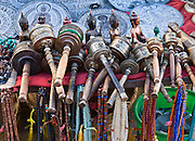 """Necklaces, prayer wheels, carved objects, metal casts for sale at Swayambhunath, the Buddhist """"Monkey Temple"""", a religious site founded about 500 AD, one of the oldest and holiest Buddhist sites in the Kathmandu Valley. Swayambhunath sits on a hill in western Kathmandu overlooking the city."""