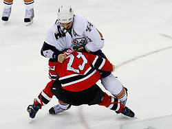 Nov 9, 2008; Newark, NJ, USA; Edmonton Oilers defenseman Sheldon Souray (44) and New Jersey Devils right wing David Clarkson (23) fight during the second period at the Prudential Center.