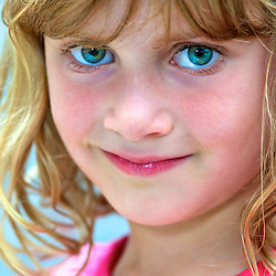 Portrait of a young girl with green eyes