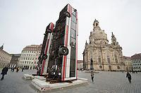 11 MAR 2017, DRESDEN/GERMANY:<br /> Temporaere Skulptur &quot;Monument&quot; von Manaf Halbouni, bestehend aus zwei Bussen, die vertikal aufgestellt sind vor der Frauenkriche, Neumarkt<br /> KEYWORDS: Omnibus, Bus
