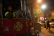 Capt. Joe McLean prepares to respond to a call from the 16th Street Fire House of the North Hudson Regional Fire and Rescue in Union City, NJ on November 07, 2013.