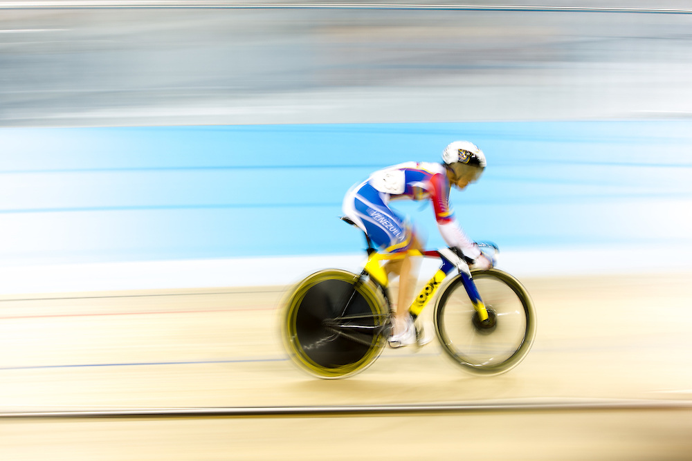 Mariaesthela Vilera of Venezuela competes in the women's cycling sprint race at the 2015 Pan American Games in Toronto, Canada, July 19,  2015.  AFP PHOTO/GEOFF ROBINS