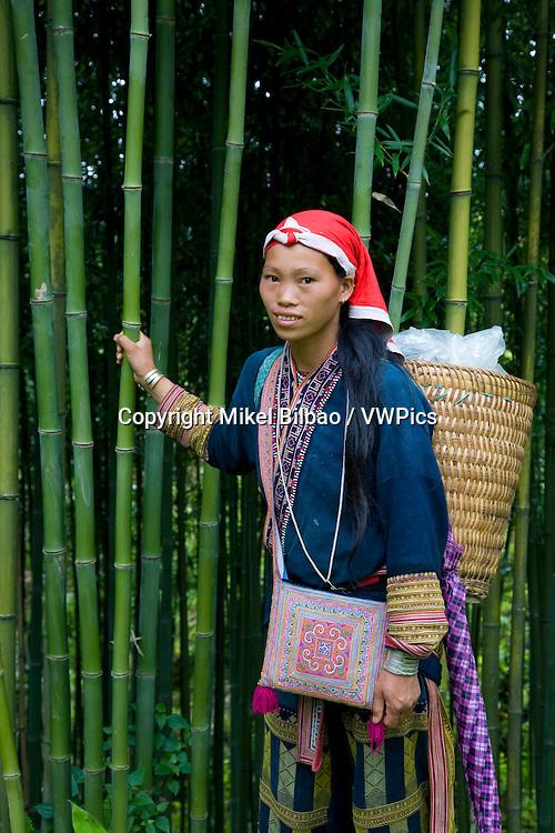 Red Dzao ethnic woman in Sapa-Ta Phin route.<br /> Sapa, Lao Cai province, Vietnam