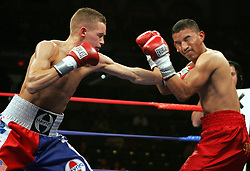 Undefeated featherweight Jason Litzau (l) and Carlos Contreras (r) trade punches during their 10 round featherweight fight.  Litzau stopped Contreras in the 6th round.  The bout took place on the undercard of the Arturo Gatti vs Thomas Damgaard IBA Welterweight Championship bout at Boardwalk Hall in Atlantic City, NJ.