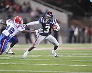 Ole Miss' Jeff Scott (3) runs from Louisiana Tech's Rufus Porter (46) in Oxford, Miss. on Saturday, November 12, 2011.