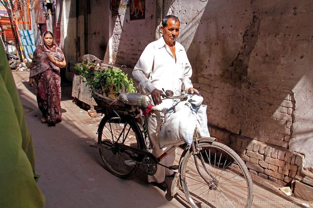 Asia, India, New Delhi. man on bicycle in Old Delhi.
